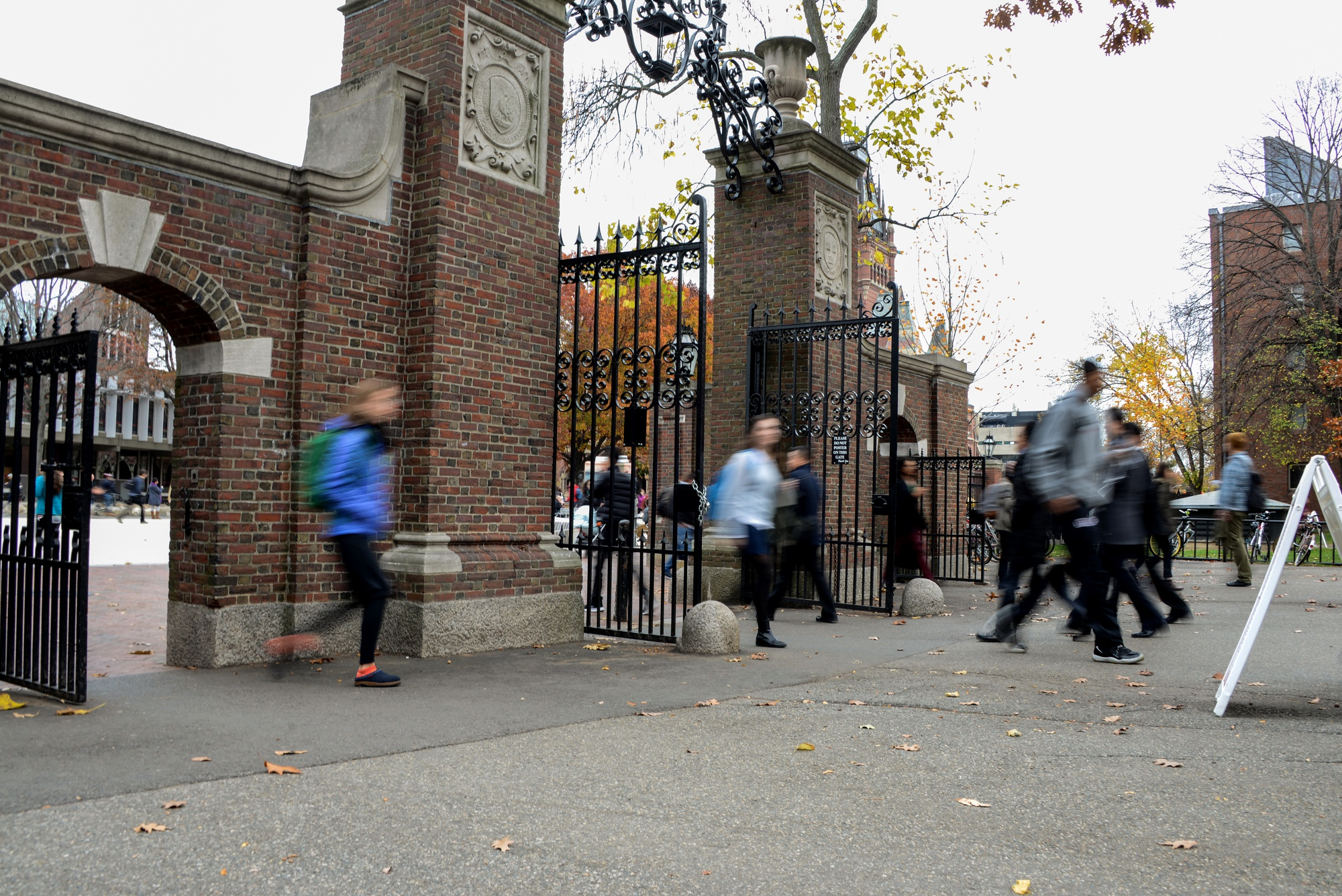 Students rush through Meyer Gate, featured as part of a historical military tour led by military veteran Specialist J. Holden Gibbons.  George von Lengerke Meyer, Class of 1879, was named secretary of the Navy in 1909 by President William Howard Taft.