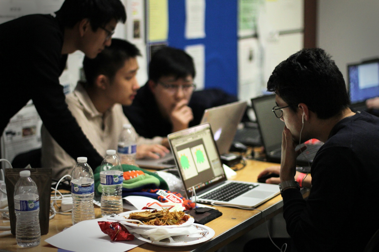 Takashi Wickes, a student at the University of Florida participating in Hack Harvard, works on graphics and code for his group's creation. Hack Harvard was a 36-hour hackathon that brought together computer programmers and tech companies.