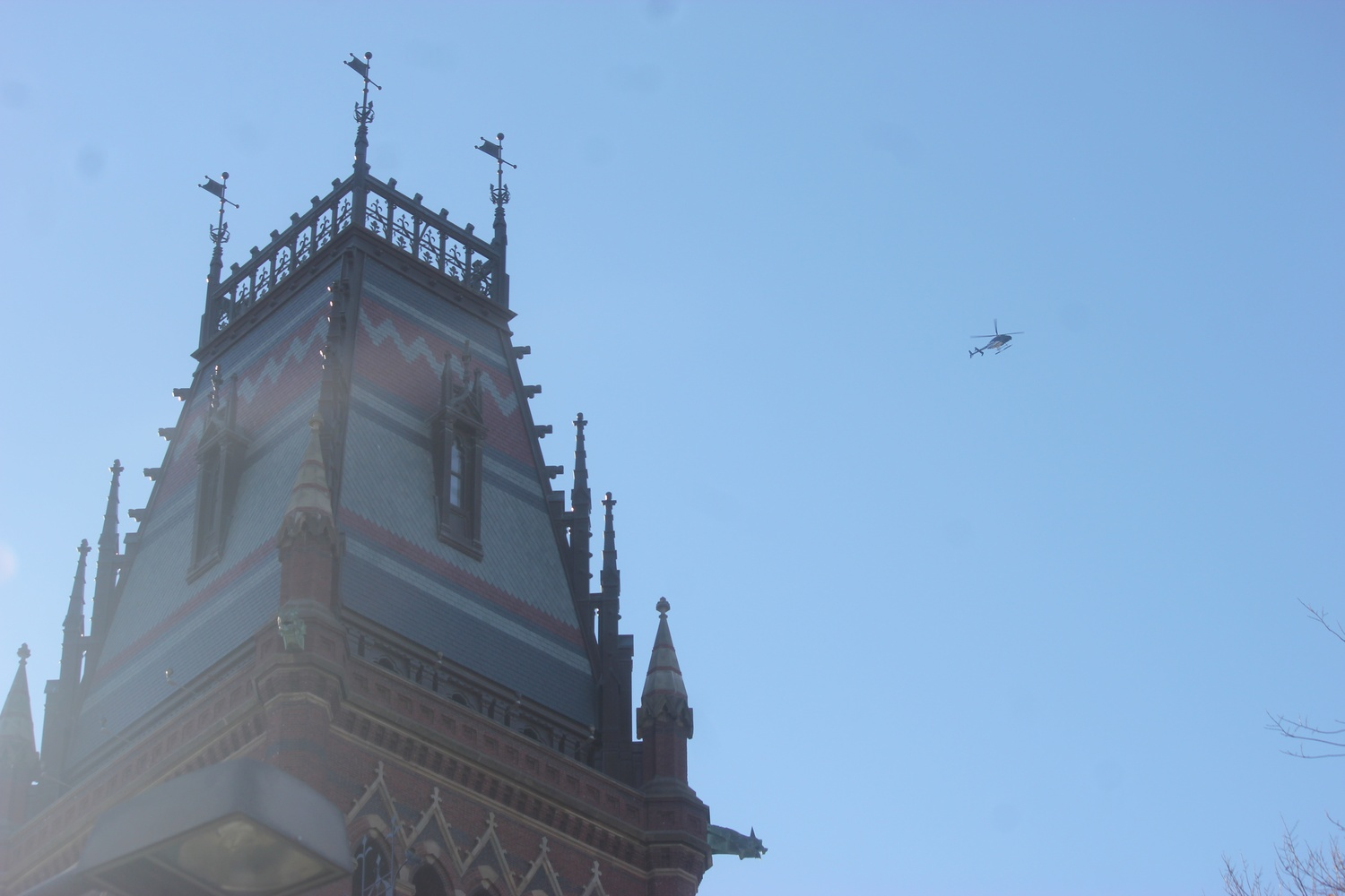 A helicopter flies over Memorial Hall following reports of an unconfirmed bomb threat on Monday.
