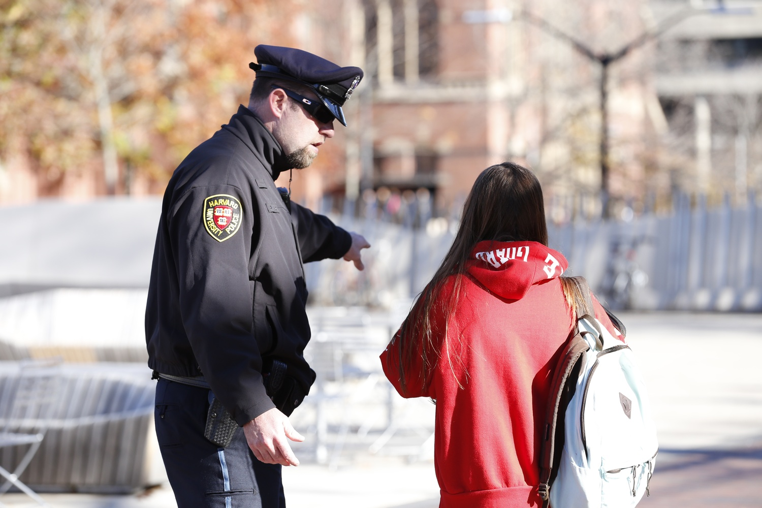A Harvard University Police officer directed people towards Annenberg Hall, which stayed open following reports of an unconfirmed bomb threat in November.