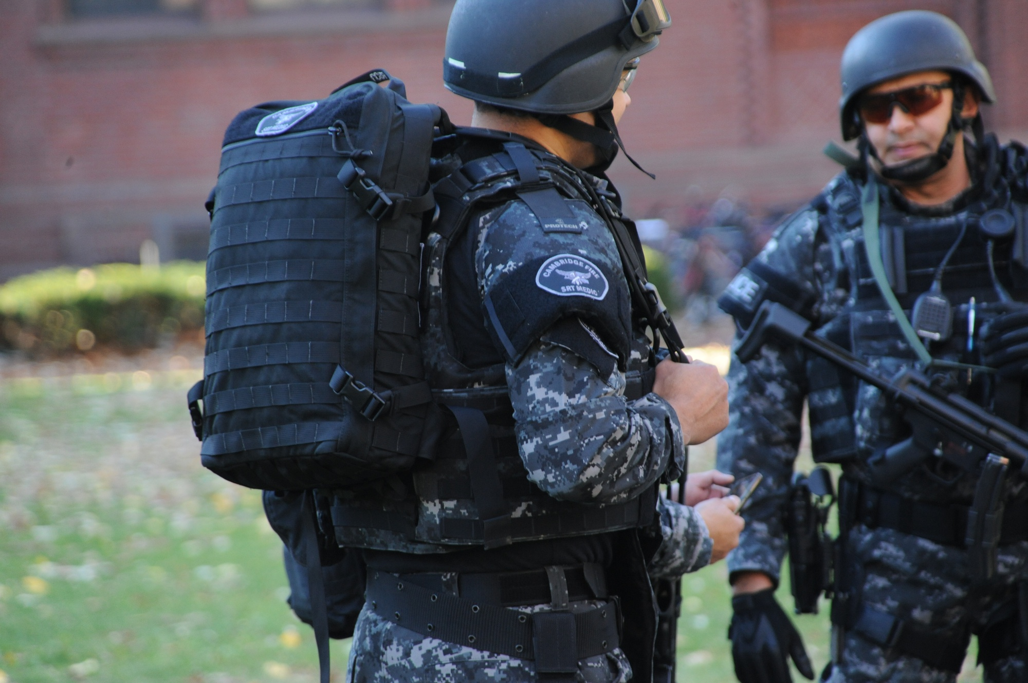 Members of the Cambridge Police Special Response Team (SRT) converge outside of Sever Hall Monday afternoon. The building was one of many evacuated during the the bomb threat.