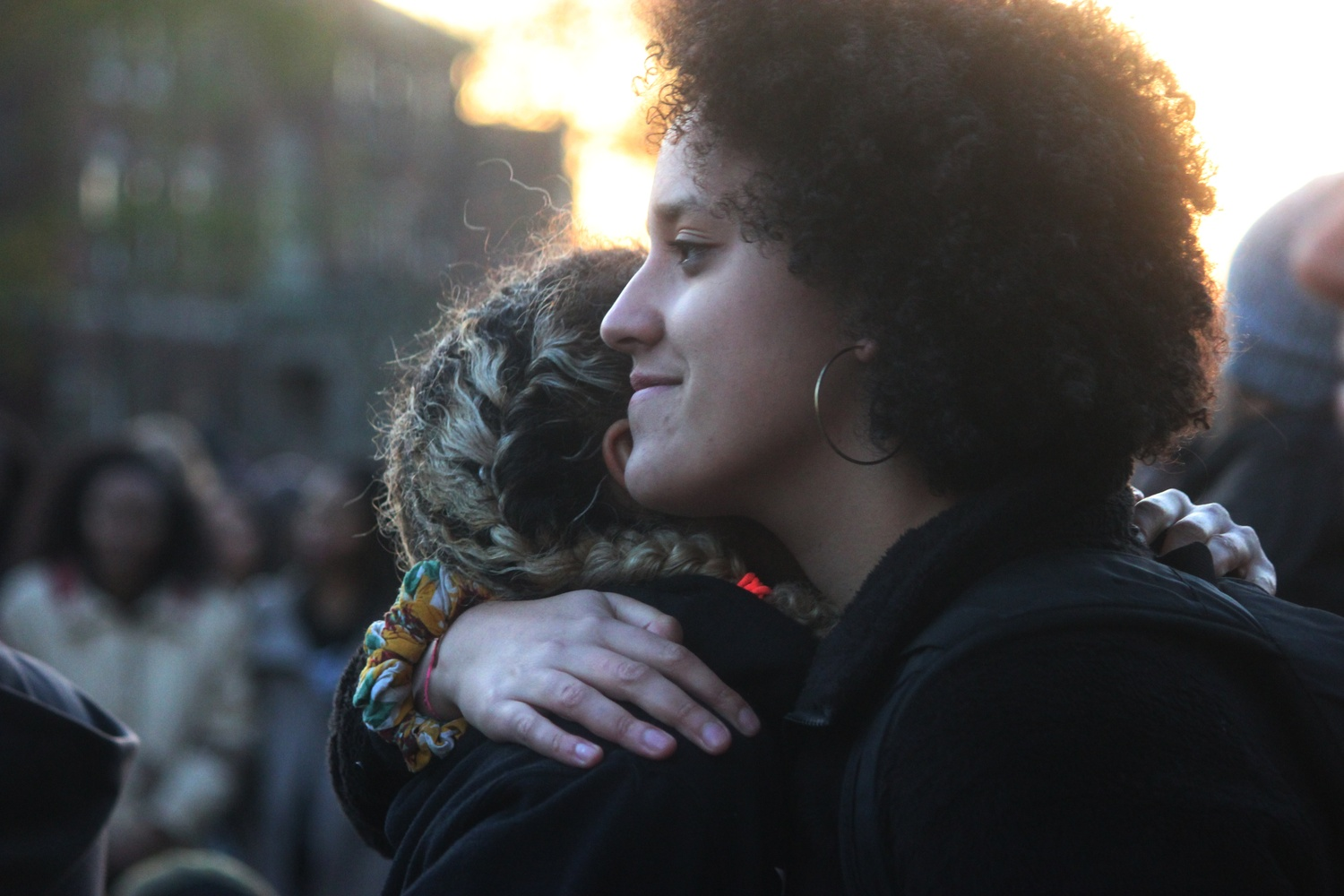 Kimiko M. Matsuda-Lawrence '16 and Jenny A. Gathright '16 embrace after performing a spoken-word poetry piece during a rally for National Call to Action Day. Members of the Harvard community gathered to march in solidarity with those who have been affected by recent incidents of racism and discrimination on college campuses.