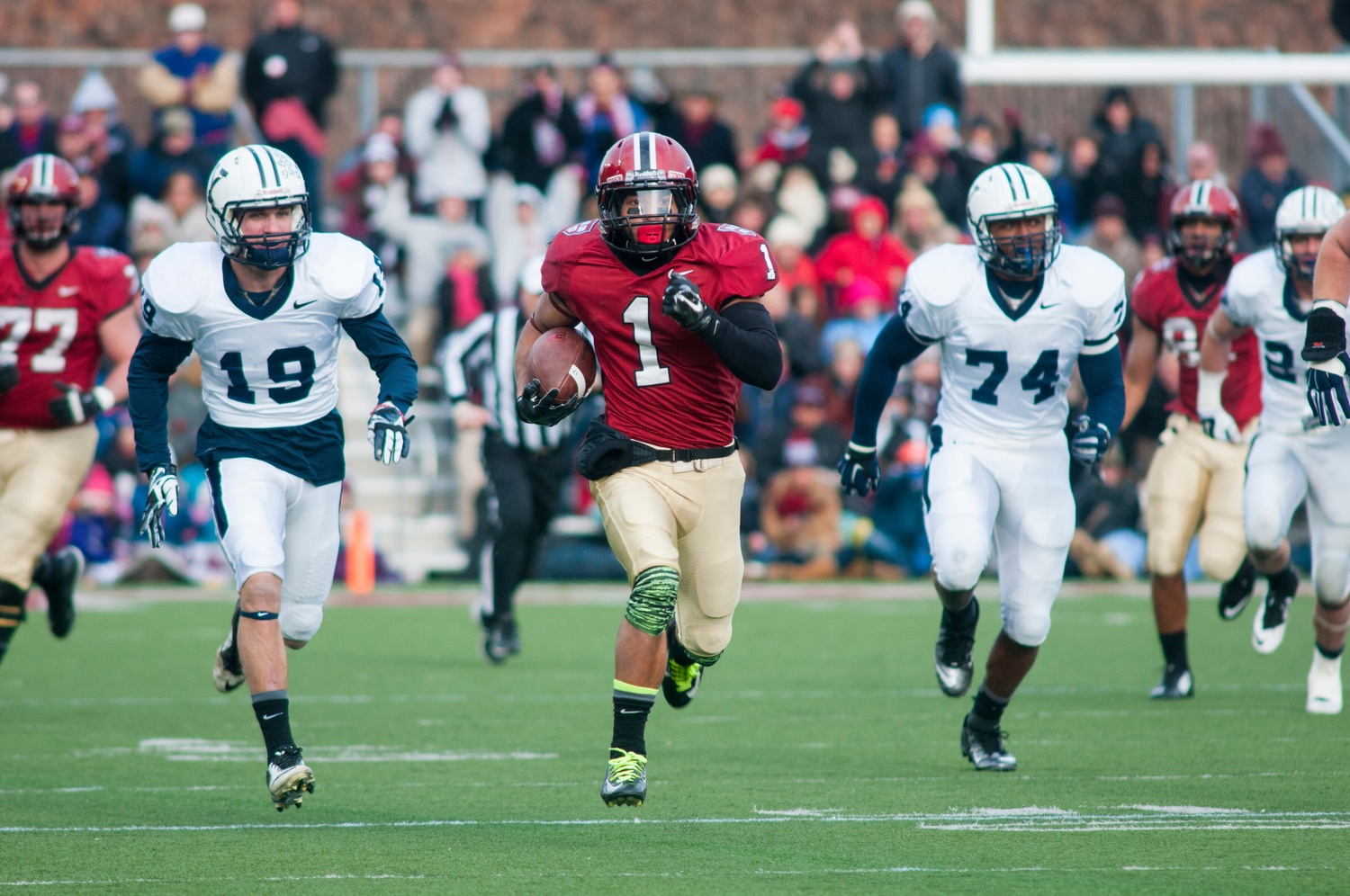 Senior receiver Andrew Fischer, pictured above in the Crimson's victory in 2014 over Yale, recorded the game-winning touchdown to top the Elis, 31-24.