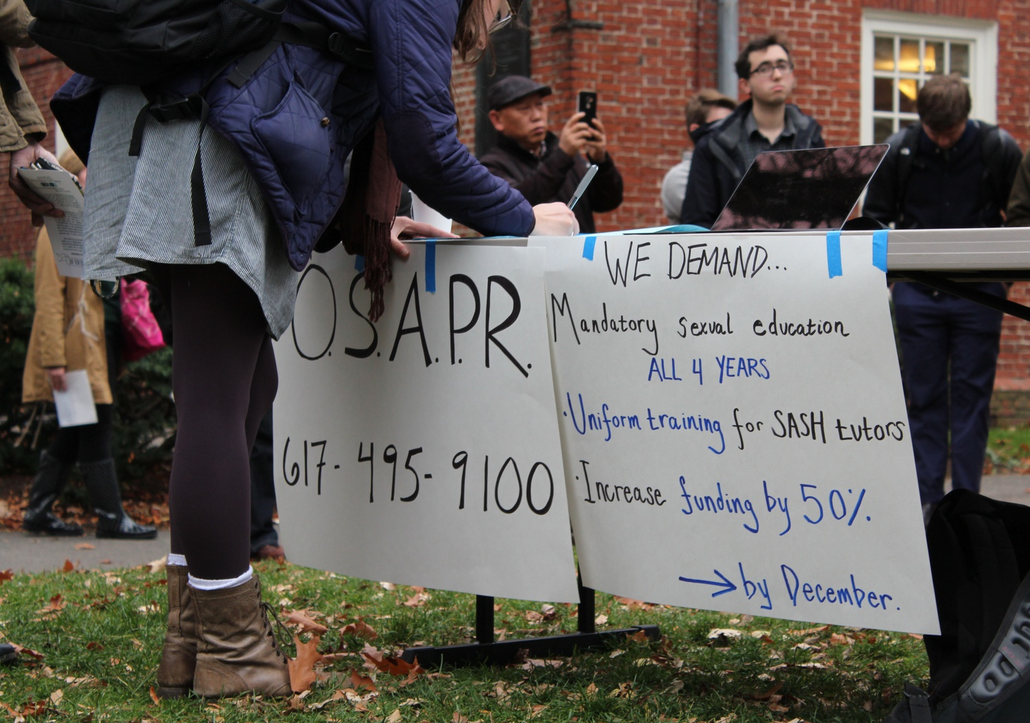 At a 2015 rally, students signed a petition in support of demands to overhaul Harvard's sexual assault prevention programs.