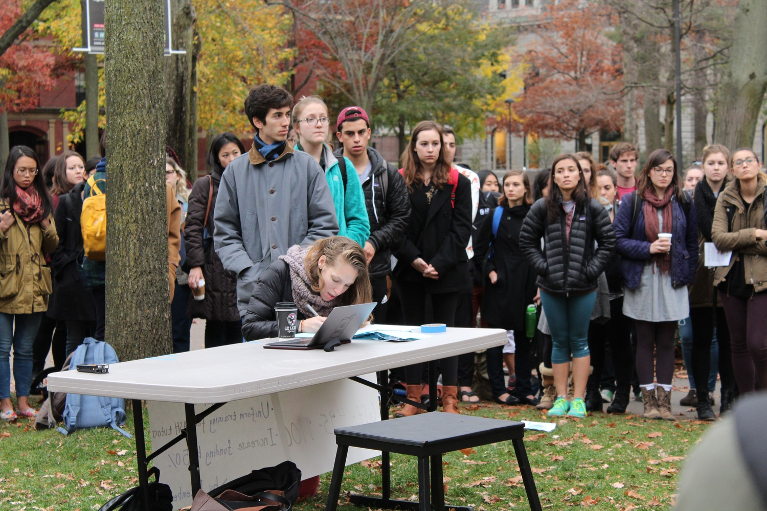Students line up to sign a petition in support of demands to overhaul Harvard's sexual assault prevention programs at a rally outside Massachusetts Hall on Thursday.Students said Harvard should require mandatory yearly sexual assault training for undergraduates and additional training for sexual violence response tutors in addition to increasing funding for the Office of Sexual Assault Prevention and Response.