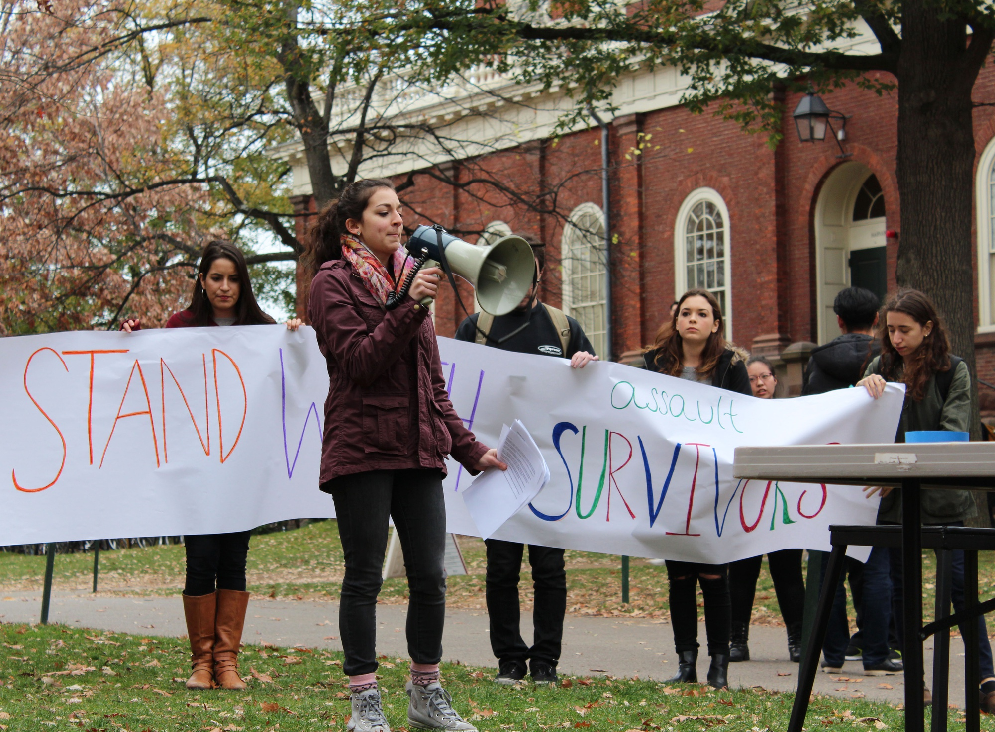 Viviana I. Maymi '16 speaks at a rally outside Massachusetts Hall where more than 80 undergraduates convened to call on the College to commit more resources and attention to preventing sexual assaults on campus.