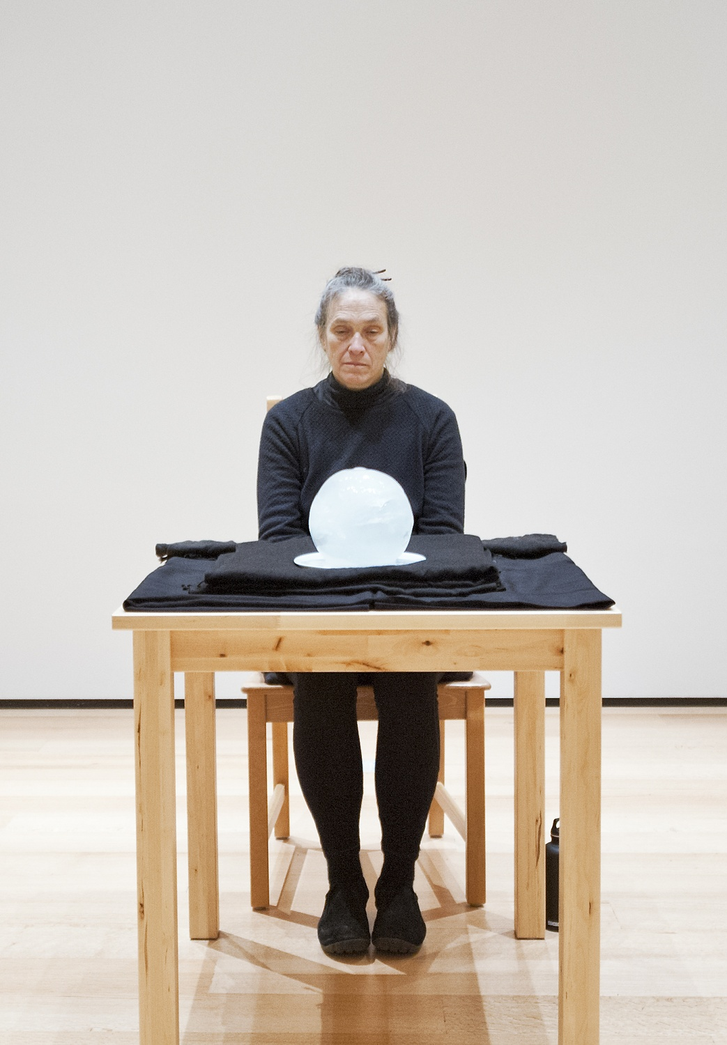 """Marilyn Arsem performs in Gallery 261 of the Museum of Fine Arts as part of the """"100 Ways to Consider Time"""" exhibit."""