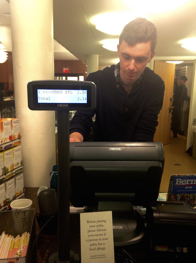 Lamont Cafe barista Mike A. Skerett '18 swipes $2 off of a poor freshman's BoardPlus.