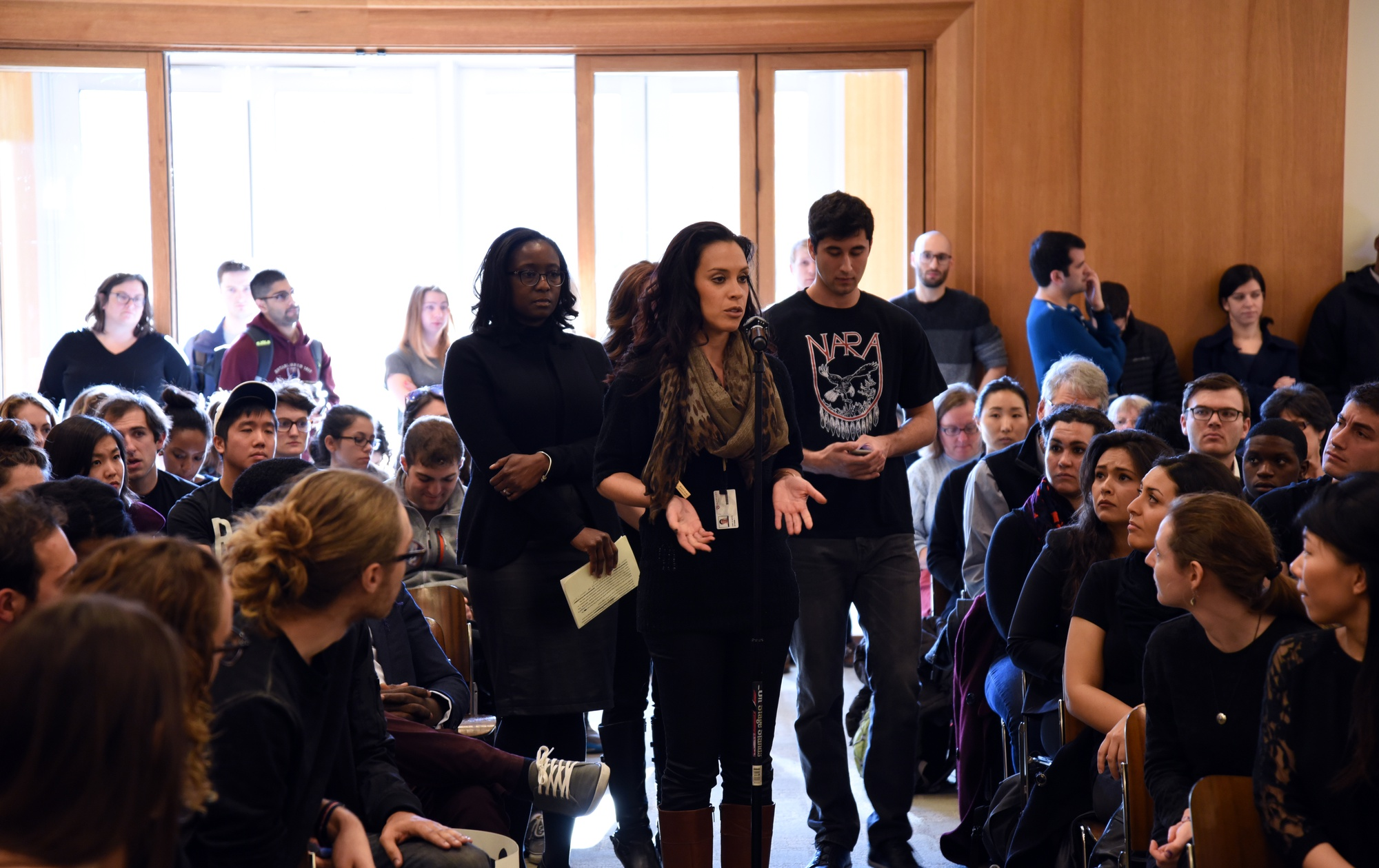"Amy E. Soto, a staff member at Harvard Law School, calls for the creation of a diversity and inclusion office at a community meeting on Friday afternoon. ""We see that we're not represented,"" she said. ""When I come to work, I ask, 'Am I welcome here?'"""