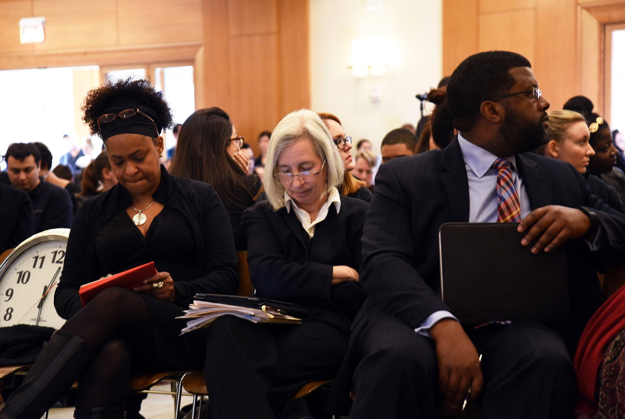 Harvard Law School Dean Martha L. Minow listens and takes notes as students voice their opinions during the community meeting on Friday afternoon.