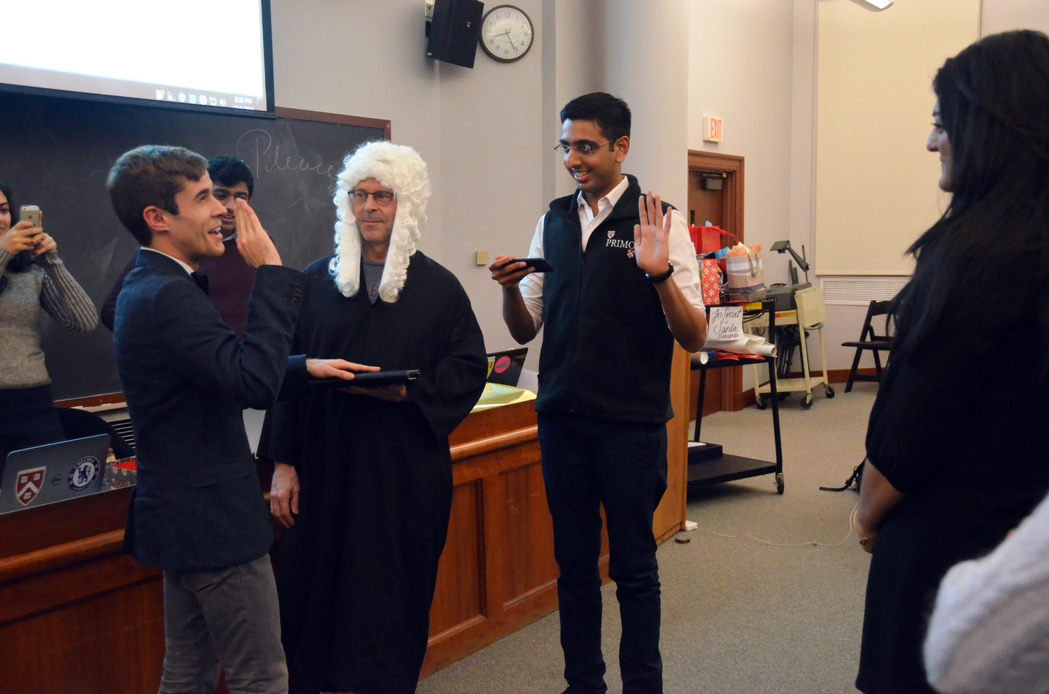 """Daniel V. """"Danny"""" Banks '17, left, recites an oath to be initiated as vice president of the Undergraduate Council on Sunday, as Dean of Student Life Stephen Lassonde and outgoing vice president Dhruv P. Goyal '16 look on."""
