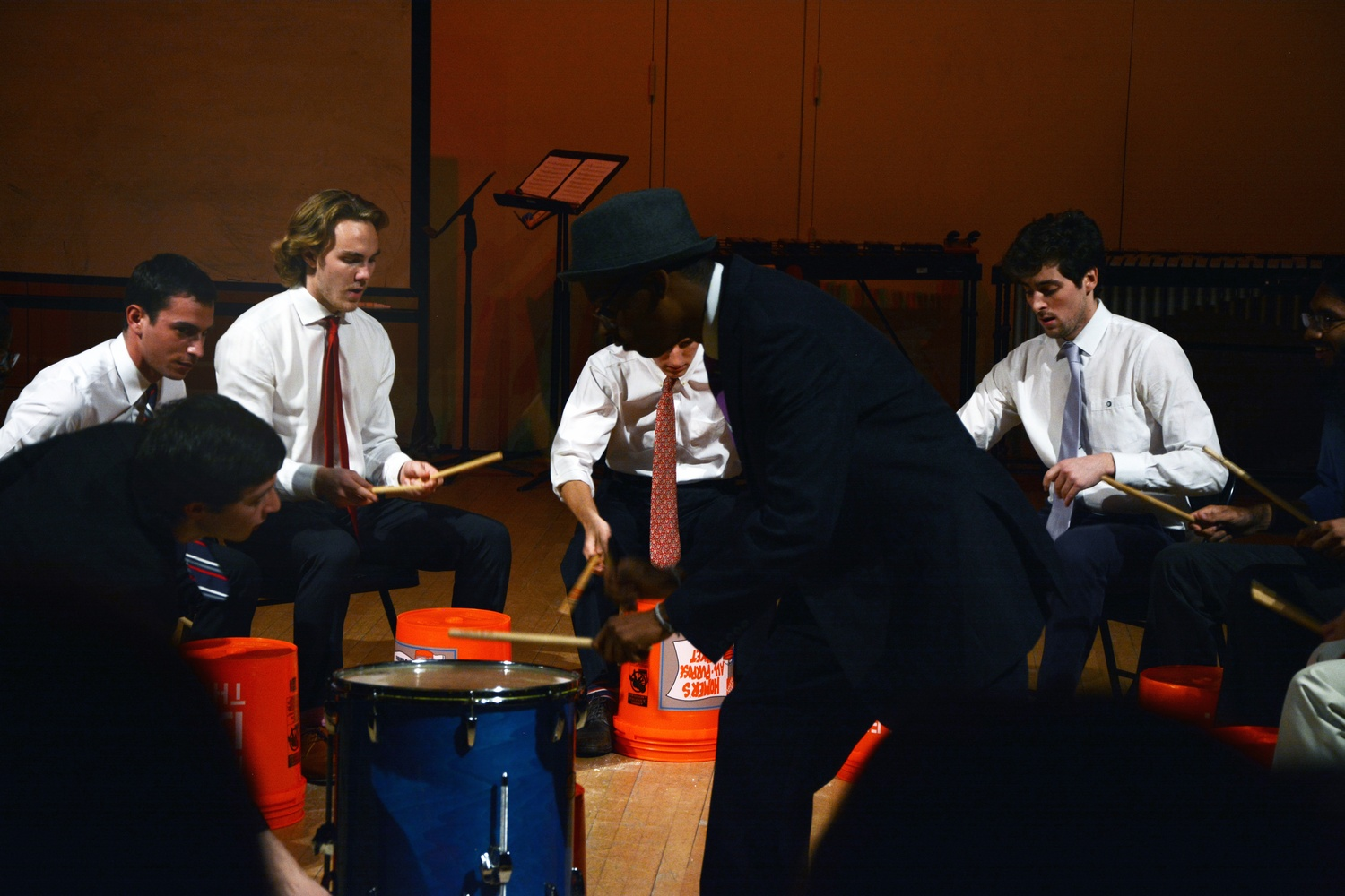 """The Harvard Undergraduate Drummers play """"Buckets"""" during their performance """"THUD News Network"""" on Sunday evening."""