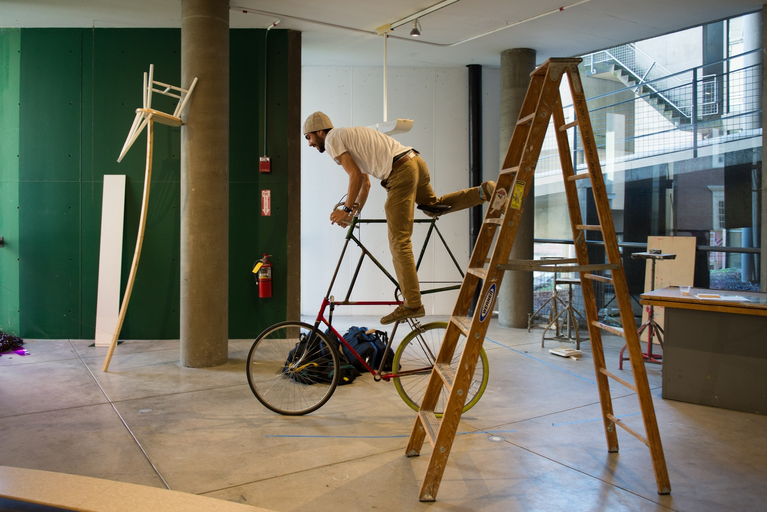 """Billy C. Orman '16 rides his """"Frankenbike"""" around the Carpenter Center. Also called """"High Horse,"""" this is just one of Orman's ouevre of modern Duchampian sculptures."""