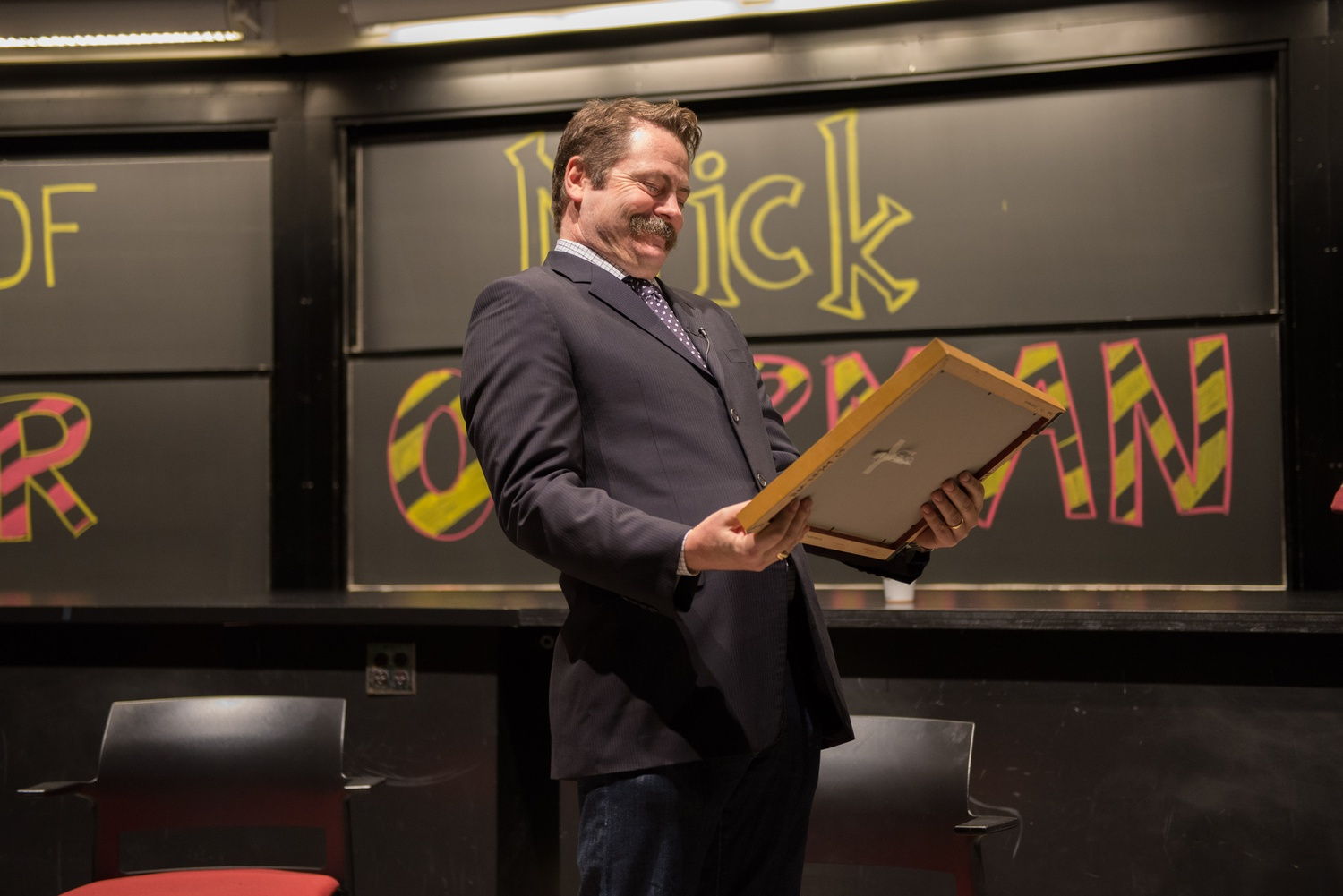 """Nick Offerman chuckles at his """"Harvard Degree"""" from IGP."""
