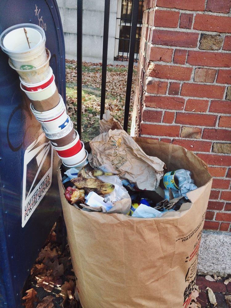 Discarded coffee cups pile up in garbage receptacles across campus as students study in advance of final exams.