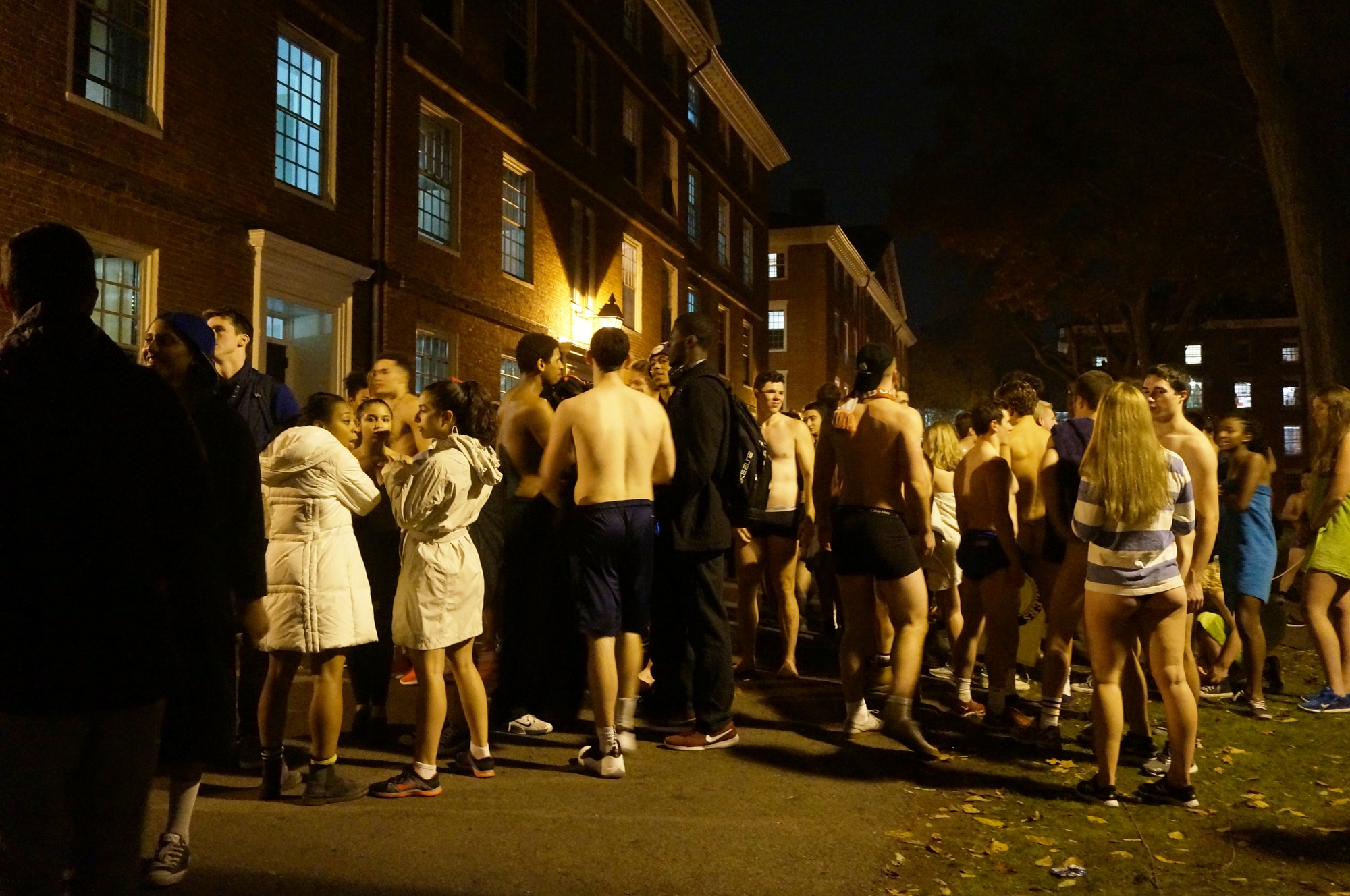 Students gather in Harvard Yard at midnight on Thursday for Primal Scream.