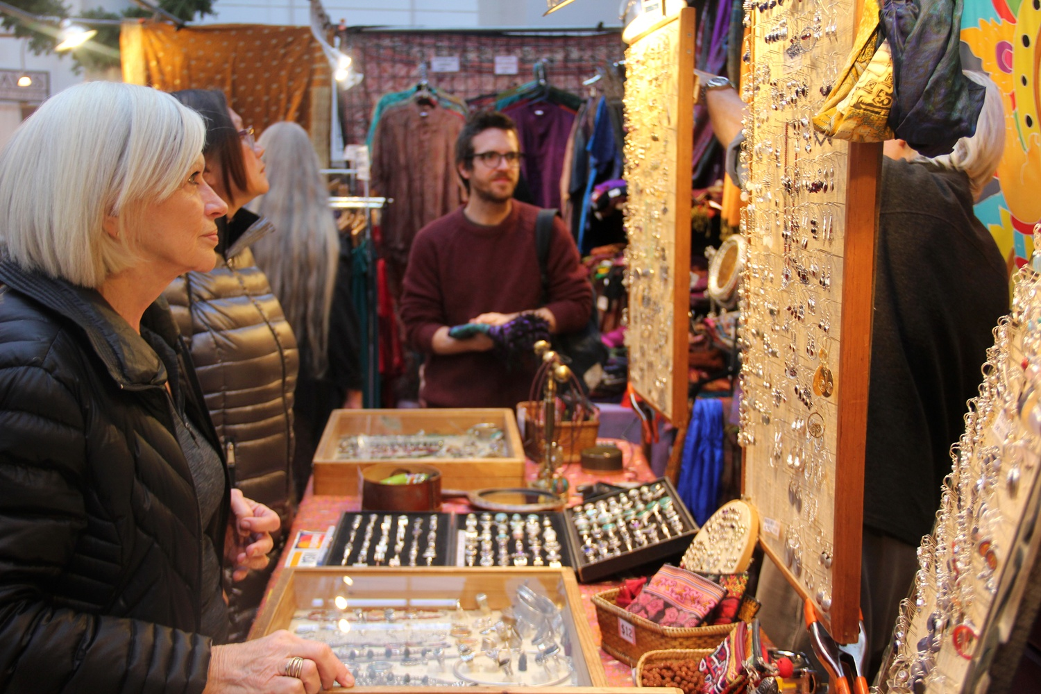 Shoppers at the 30th annual Harvard Square Holiday Fair browse the many vendors around square this weekend. Local and global vendors sold a wide range of crafts, including jewelry and artwork.