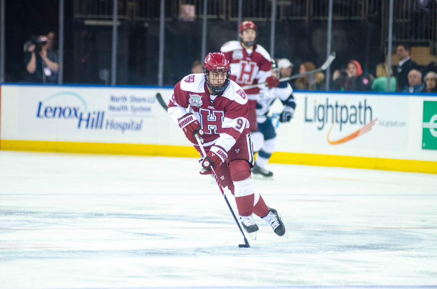Junior forward Luke Esposito, shown during last year's installment of the Rivalry on Ice, has nine points for the Crimson this season.