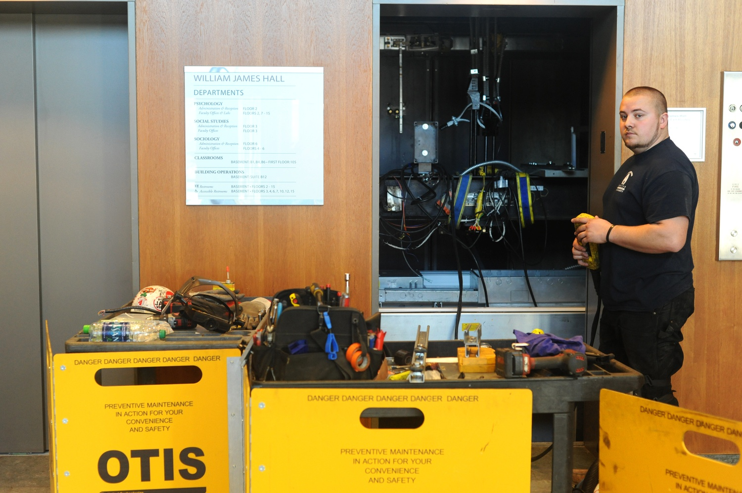 Chris Weenen performs maintenance on an elevator in William James Hall Monday afternoon.
