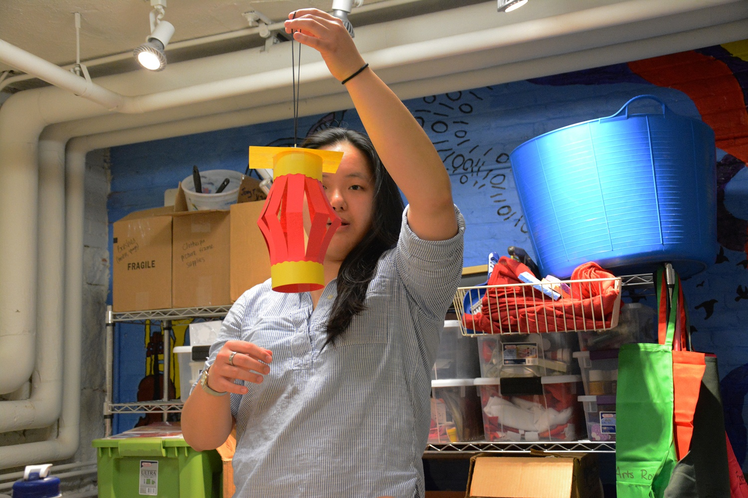 Enya Huang '19 crafts a paper lantern to celebrate the Chinese Spring Festival  in the Freshman Arts Room on Wednesday.