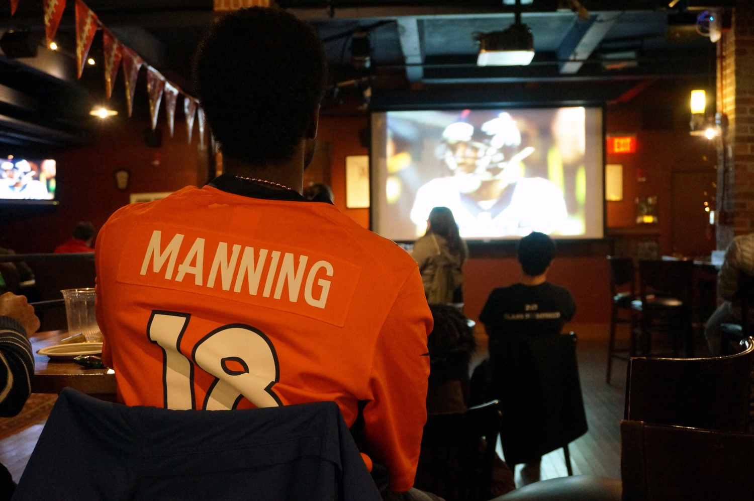 Students watch as the Denver Broncos defeat the Carolina Panthers with a final score of 24-10 during the Super Bowl on Sunday night. This watch party in Cambridge Queen's Head was one of many on campus.