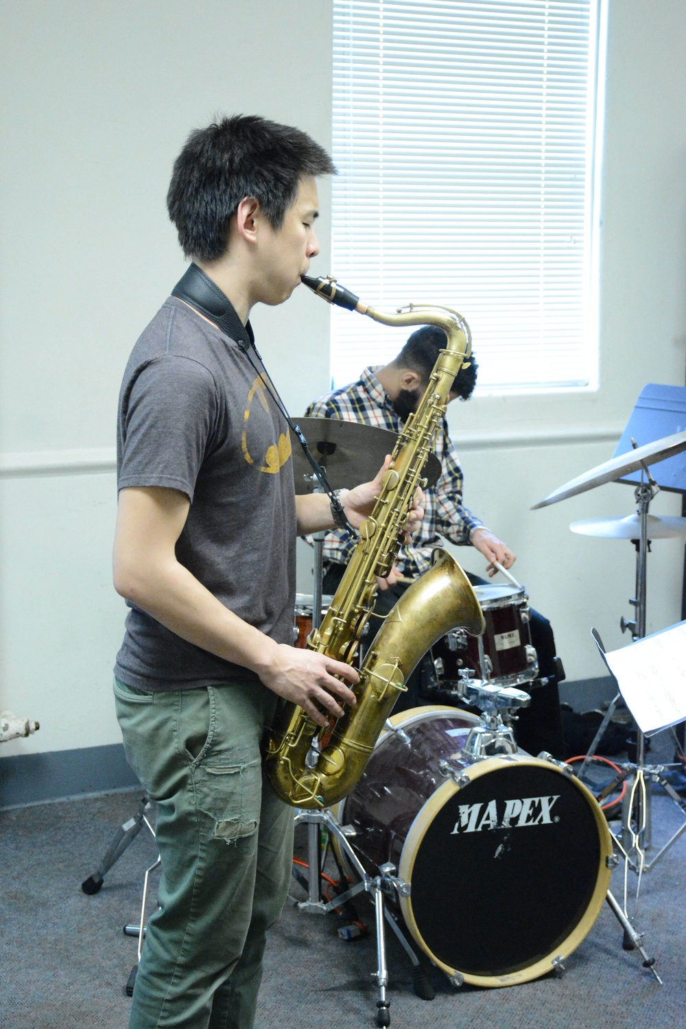 Saxophonist Kevin Sun '14, a former FM exec, rehearses with Great on Paper at the New England Conservatory of Music on Tuesday, February 2.