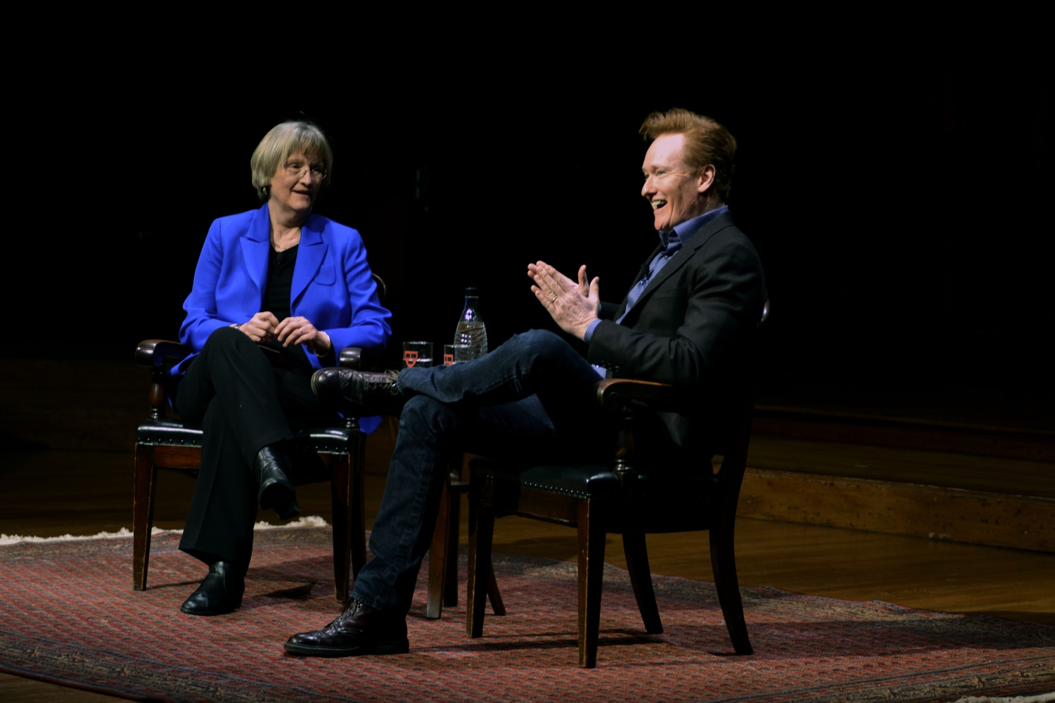 Conan C. O'Brien '85 speaks at a campus event with former University President Drew G. Faust in 2016.