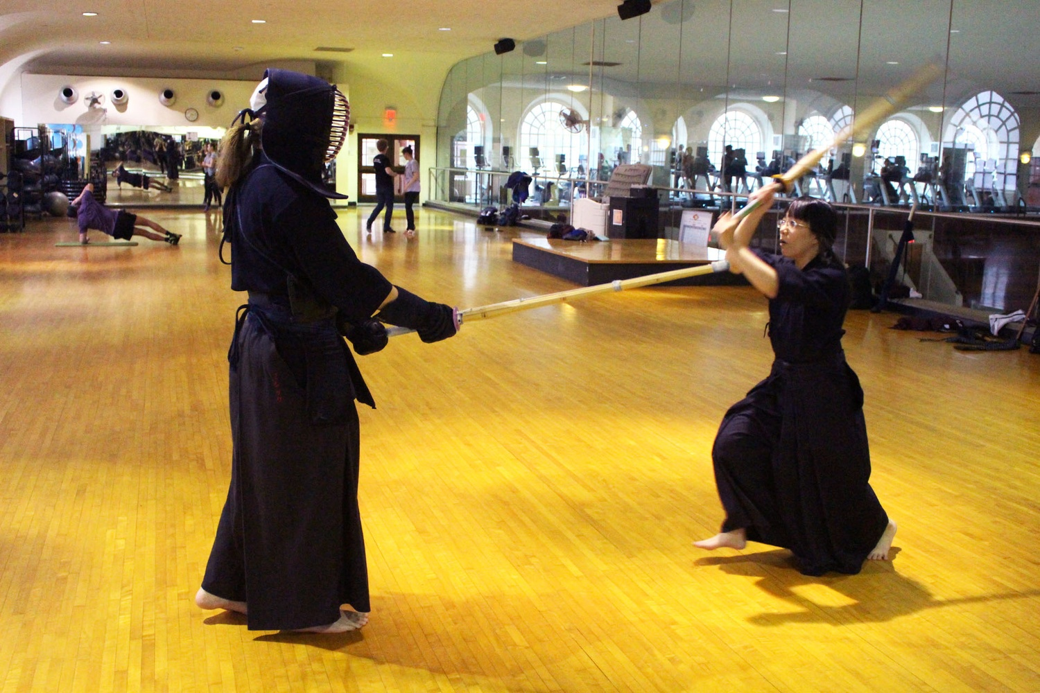 """Members of Harvard's Kendo Club gathered on Tuesday to show off their unique sport. On the appeal of Kendo as an activity and an art form, Mary Beth Schleicher, '18, offered her own perspective: """"Kendo is more than just a sport. It's also about learning to look at things in a new way."""""""