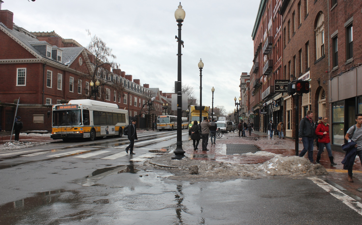 Despite a weekend of subzero temperatures in the area, melting snow filled the streets of Cambridge as a unusually warm high of 55 degrees Fahrenheit hit the area on Tuesday.