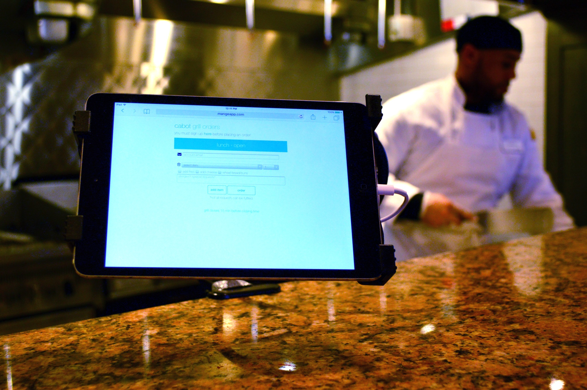 A tablet computer is now positioned in the Cabot House dining hall. A newly implemented dining system requires Cabot students to submit their orders to the cafeteria grill online.