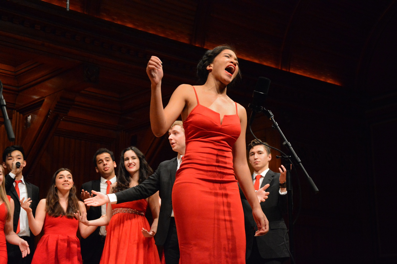 "Asia T. Stewart '18 sings as a member of The Harvard Lowkeys a capella group in Sanders Theatre on Friday night. The Harvard Lowkeys and The Harvard Opportunes both performed in the show ""Major Key: A #BlessOpp Jam."""