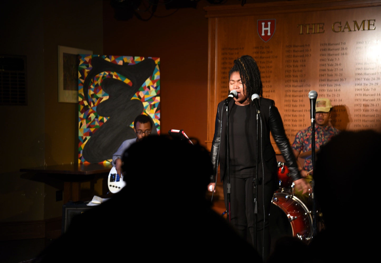 """Aleigha Durand, a local high school student, performs """"Feeling Good"""" during """"Sing It, Sister"""" at the Queen's Head Pub on Friday evening. """"Sing It, Sister"""" was the first event of the 2016 Black Arts Festival, hosted by the Kuumba Singers of Harvard College."""