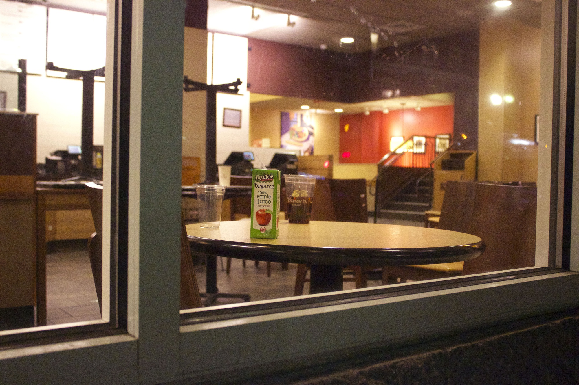 A juicebox and soda sit abandoned on a table after Panera announced that it is closing indefinitely.