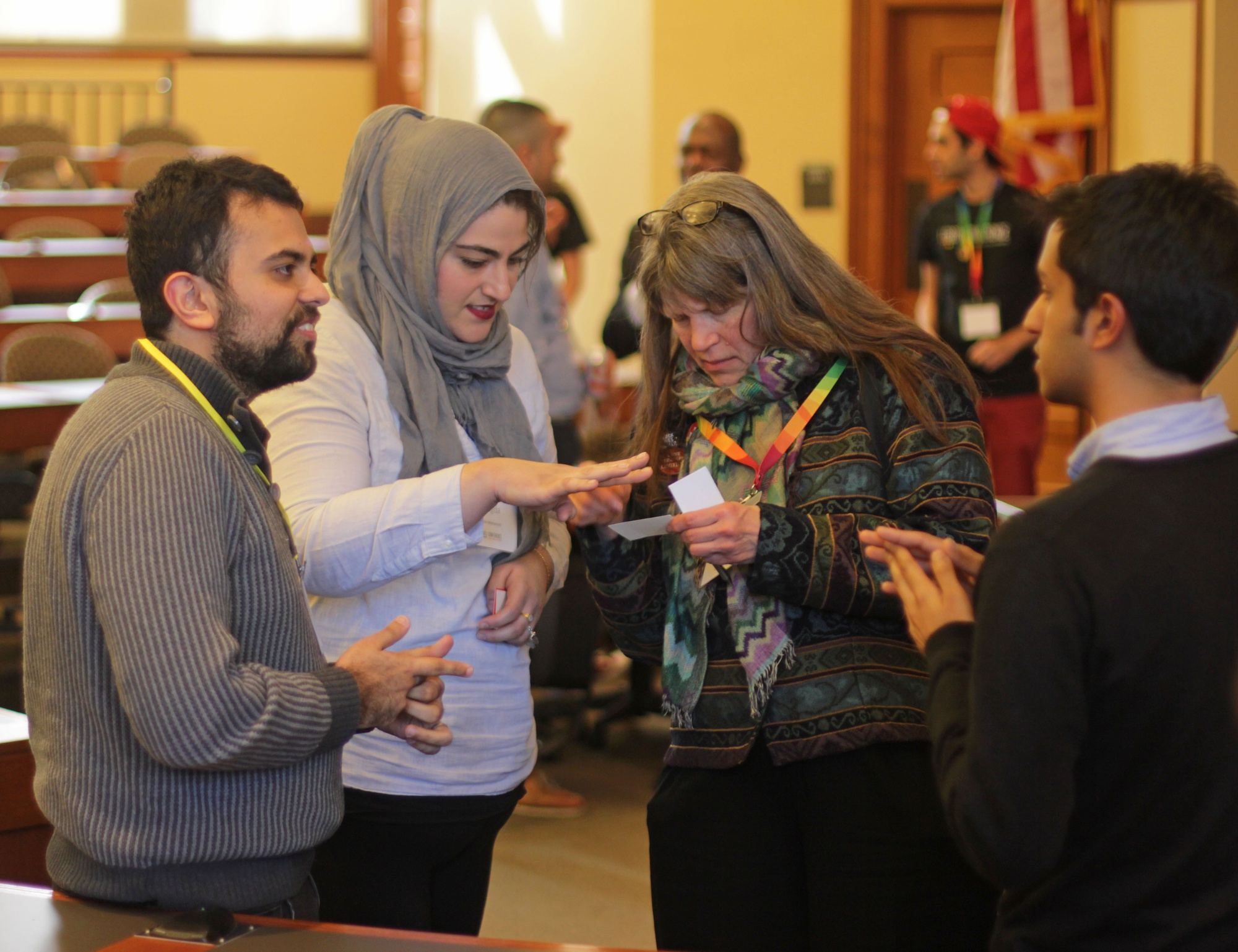 "Conference attendees mingle after the ""Comparative Religions"" session at the LGBTQ Conference at Harvard. The third edition of the conference, the theme of which was ""Beyond Marriage Equality: Rainbows at the Crossroads,"" took place this weekend on the law school campus."