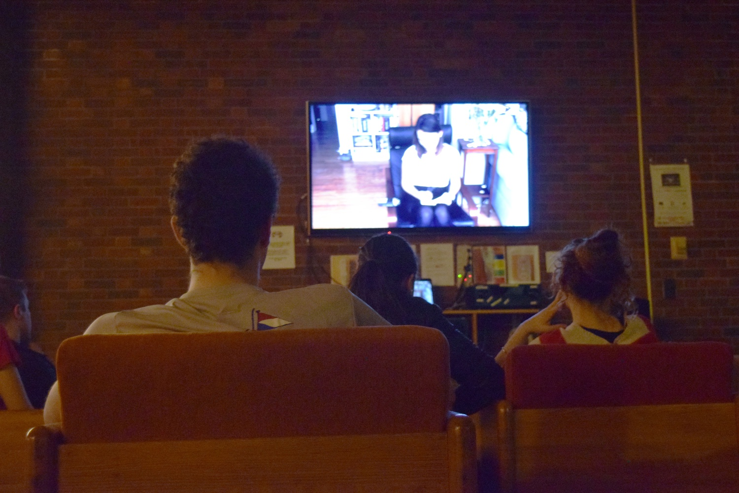 Students watch the premiere of Mather Be, Mather House's 2016 Housing Day video, which parodies Clean Bandit's song Rather Be.