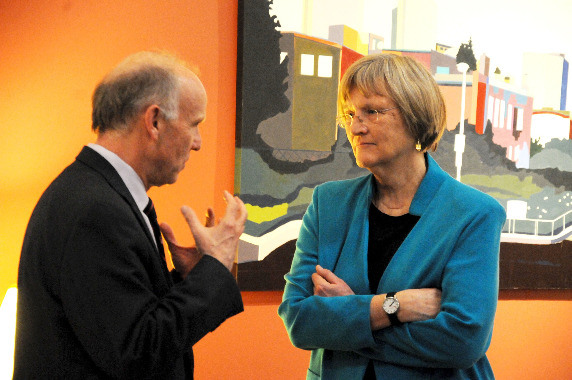 President Drew Faust is greeted by Currier House Faculty Dean Richard W. Wrangham in the Currier Senior Common Room Tuesday evening. President Faust was welcomed to Currier as part of its monthly speaker series, Currier Conversations.