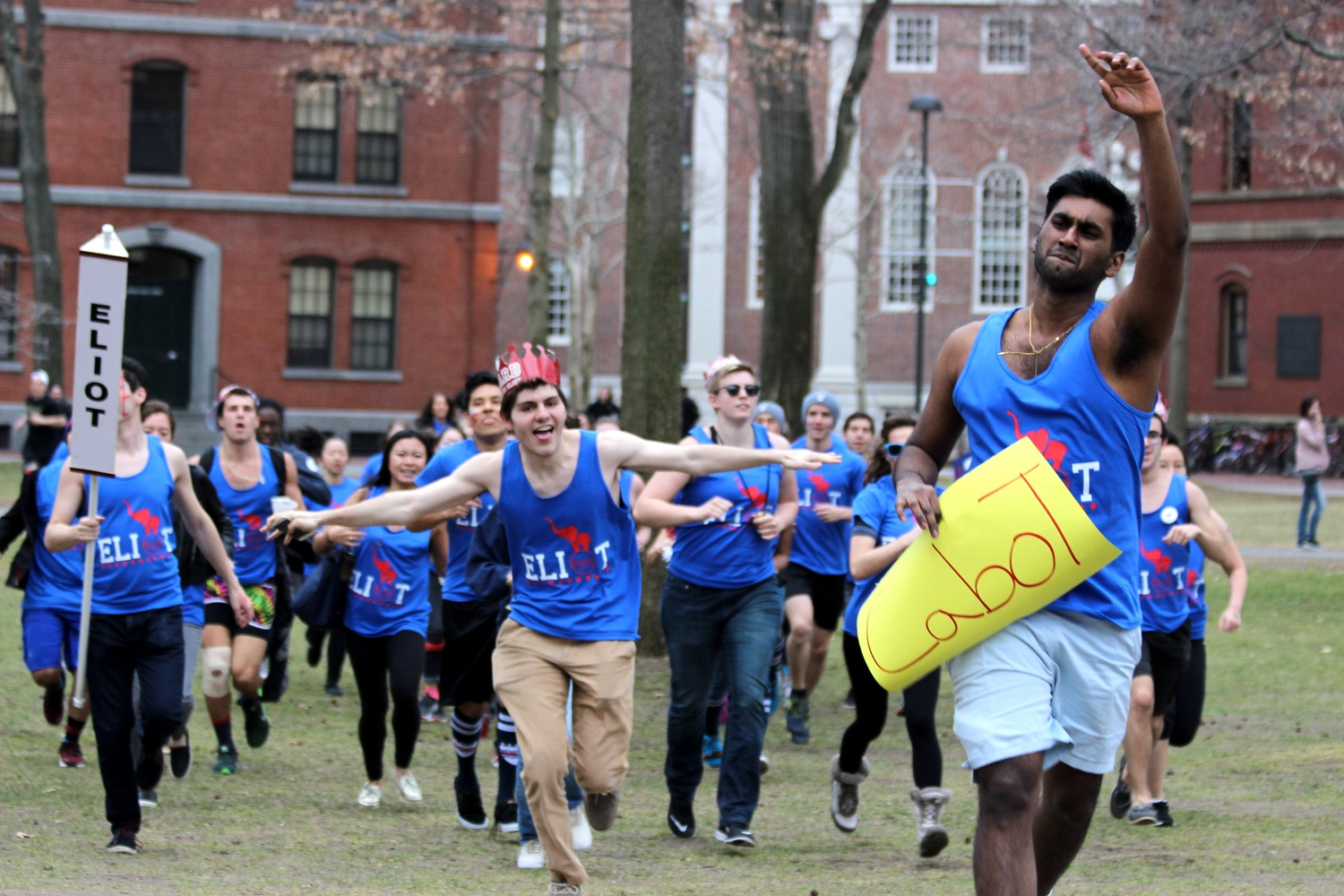 Members of Eliot House charge into Harvard Yard pn Housing Day.