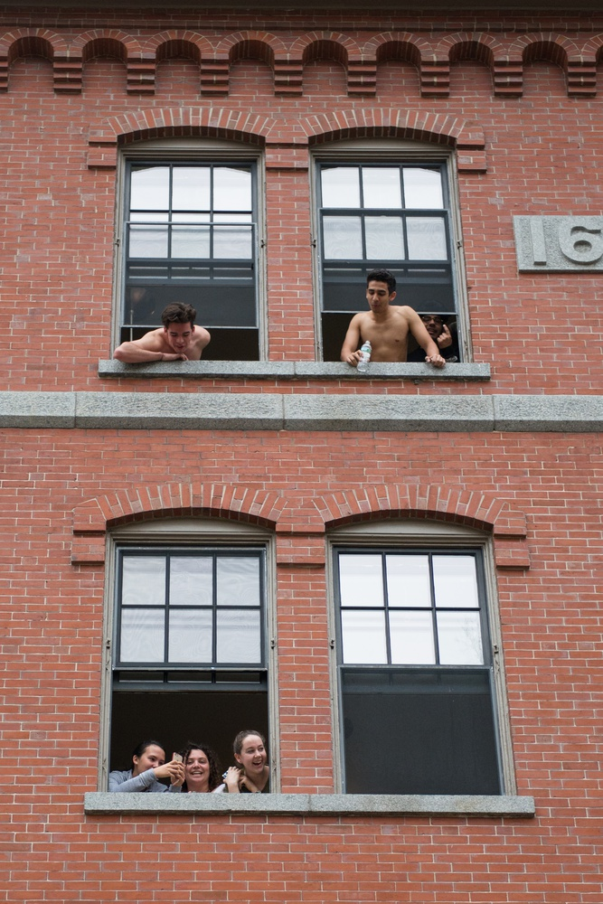 Freshmen in Grays Hall eagerly look out into the yard, awaiting their letters.