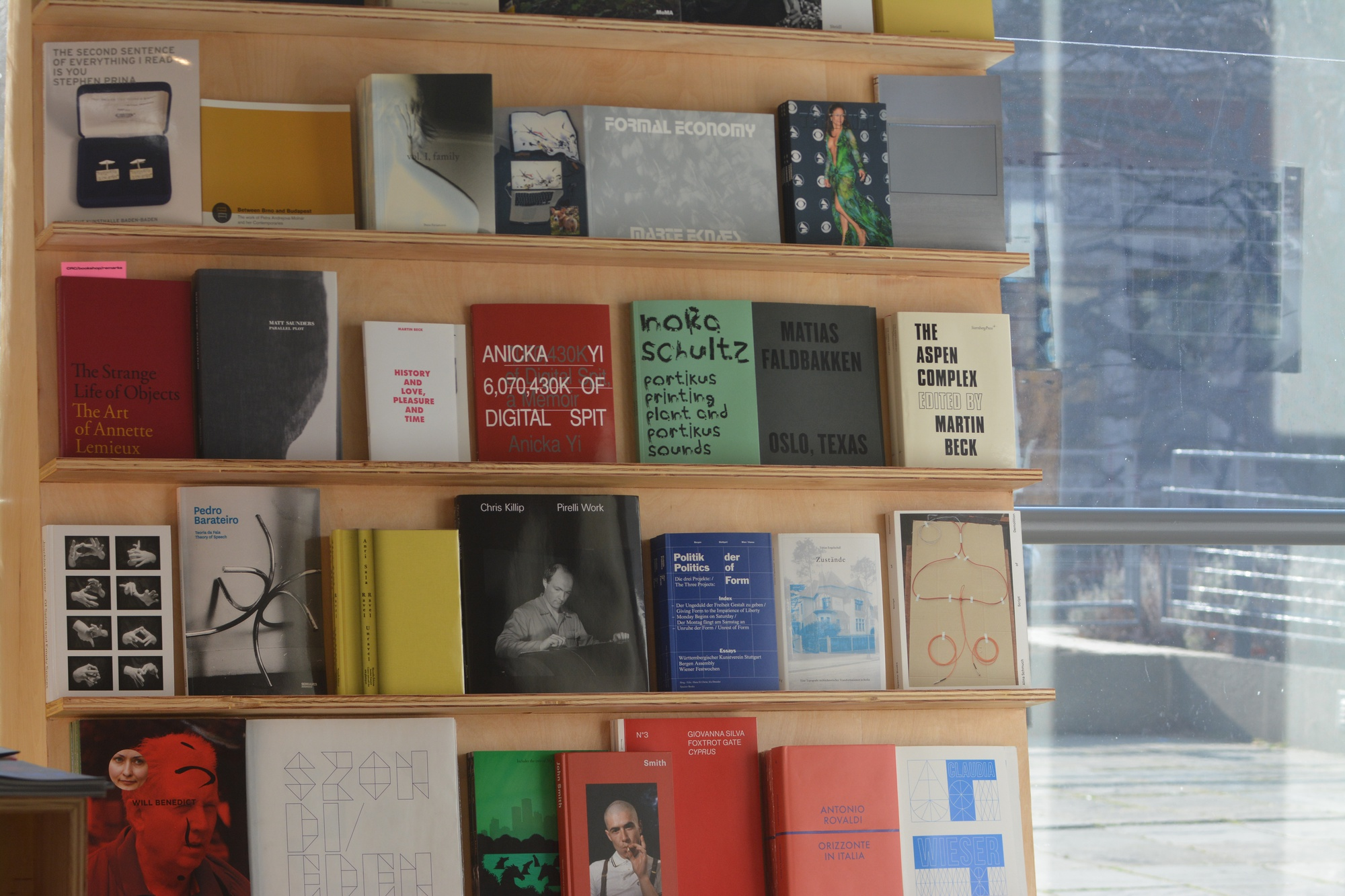 Books line up near the window of the Consumer Research Center/bookshop, an exhibit at the Carpenter Center for the Visual Arts