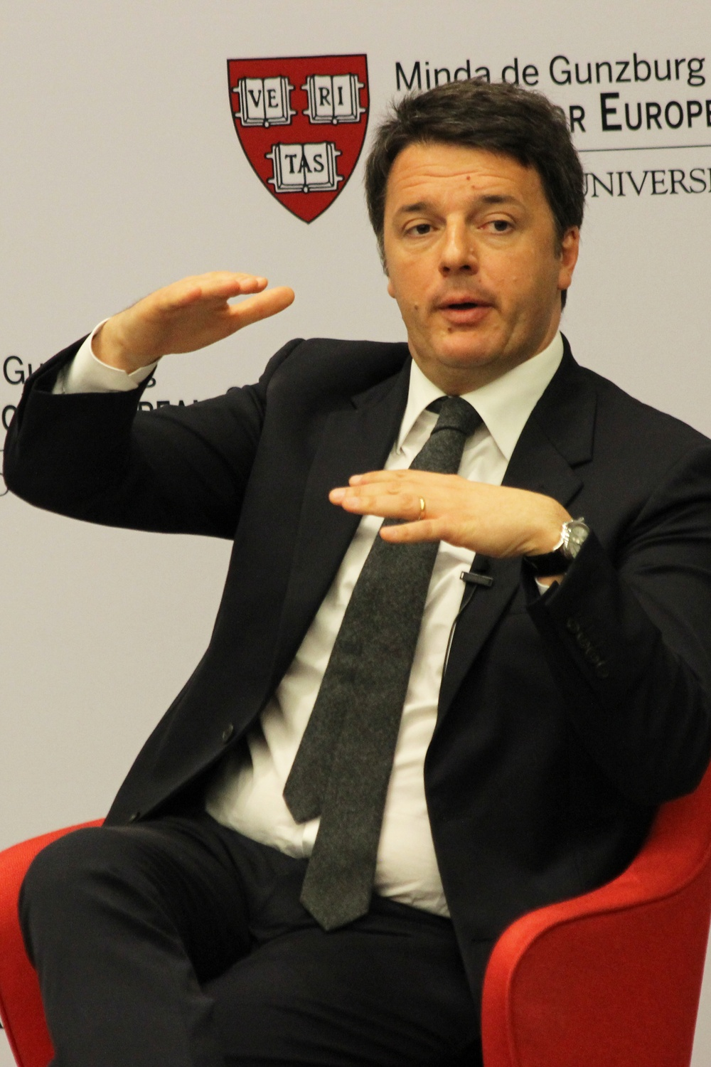 Italian Prime Minister Matteo Renzi speaks to a packed auditorium at the Harvard Art Museums Thursday morning. Mr. Renzi highlighted the importance of valuing individuals as unique citizens instead of mere numbers in light of recent terror attacks in Europe.