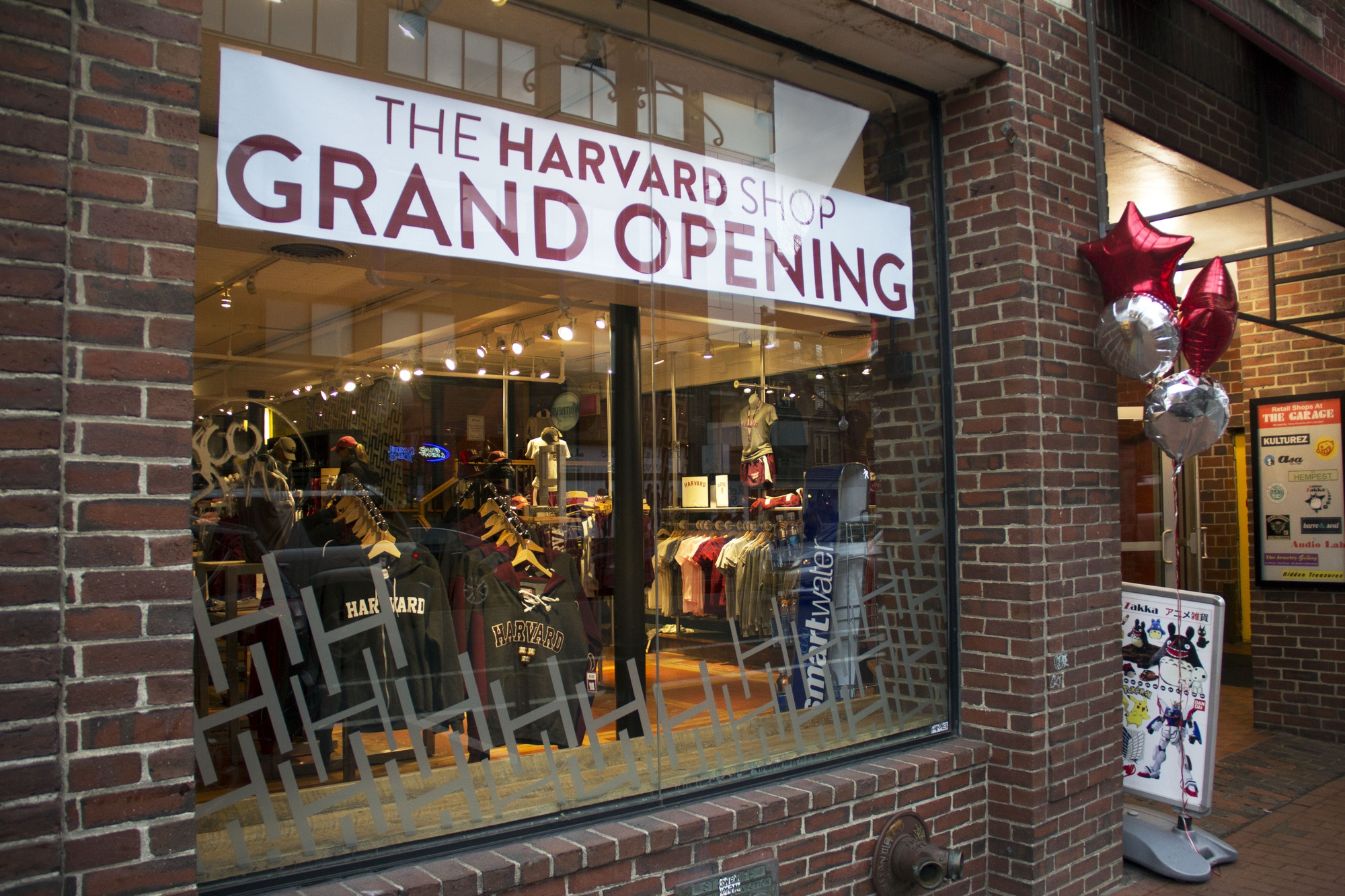 The Harvard Shop celebrated the opening of a new location in The Garage at 34 JFK Street with a store-wide sale, free food, giveaways, and student-performed music. The Harvard Shop, a student-run business, is a subsidiary of the Harvard Student Agencies.