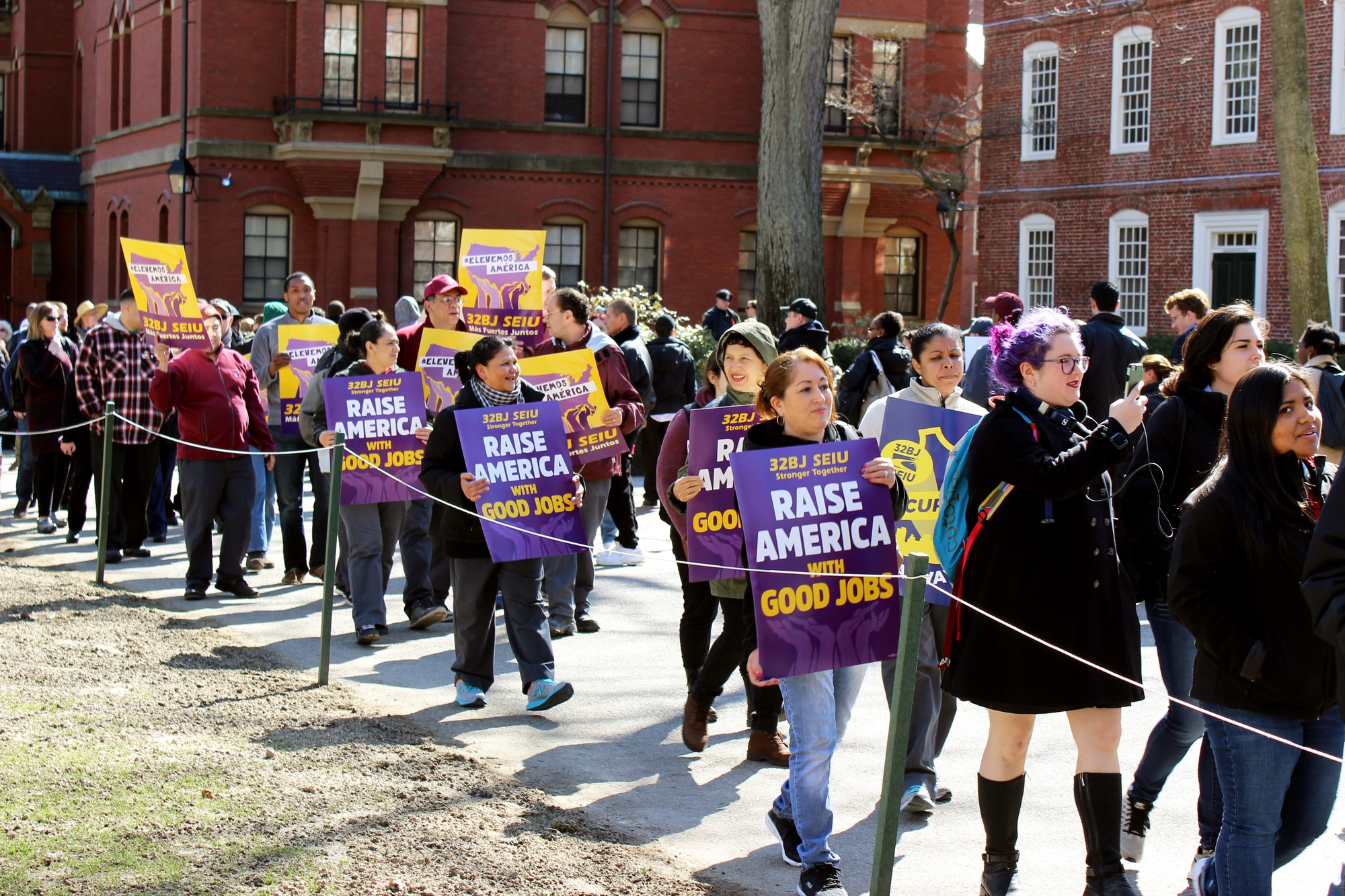 """Over 200 Harvard affiliates gather to protest for higher wages and increased health benefits for Harvard University Dining Services Workers. The rally is the latest in a series of events SLAM has hosted since launching their """"One Harvard"""" campaign."""