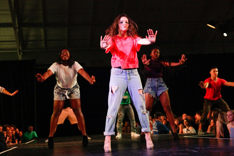 Tiana J. Raphel '16, Kristen M. Somple '16, and Jessica Ekeya '19 perform in Eleganza.
