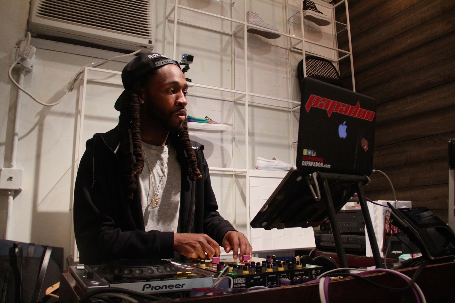 At Bodega, music is a large part of the shopping experience. DJ Papadon controlled the tracks on Monday with a wide mix of music genres. He stood a step up in the back of the store, visible from every corner, in direct eyesight as customers walked in.