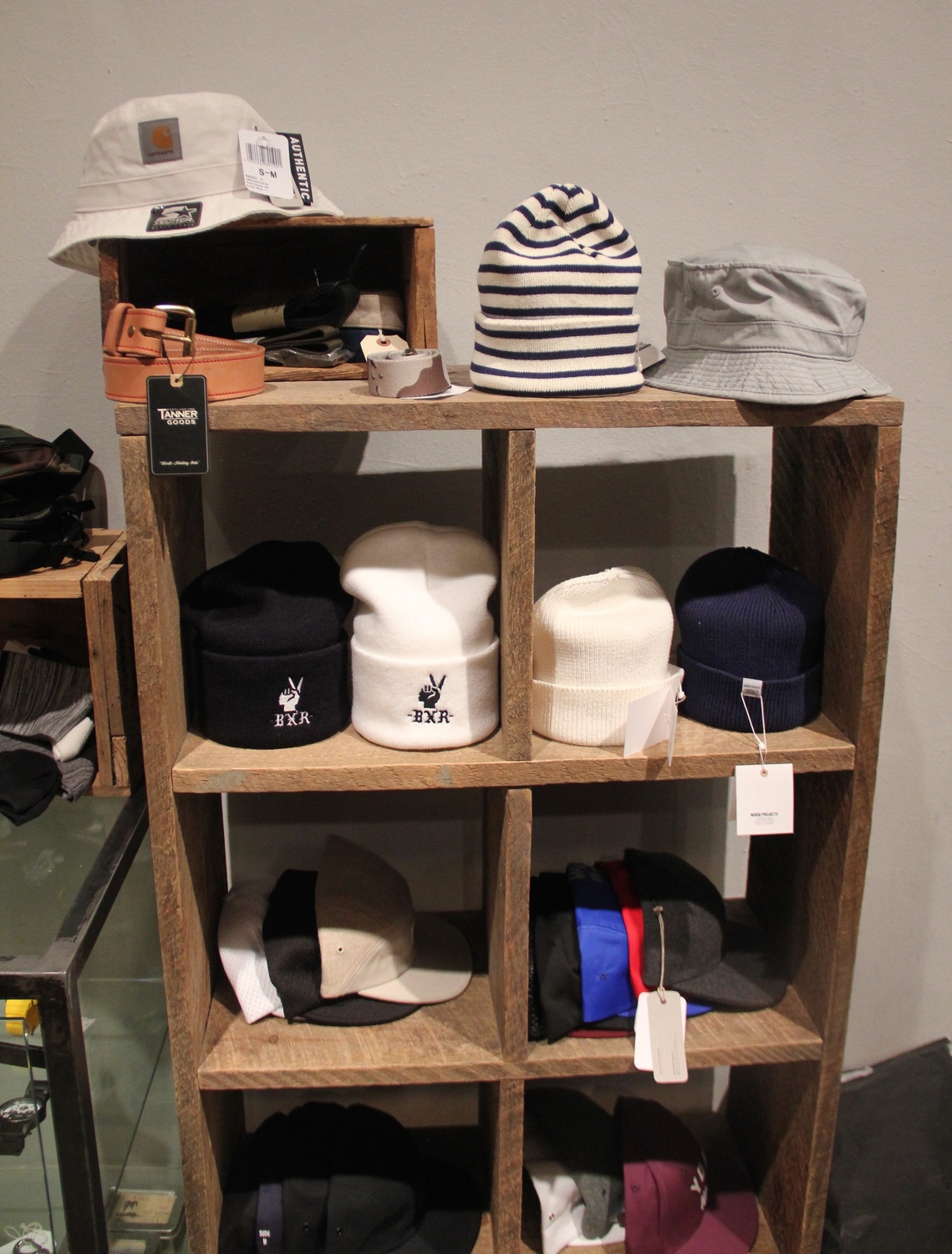 Beanies and bucket hats are trendy as well; Bodega sells the latest styles in simple, workable colors.