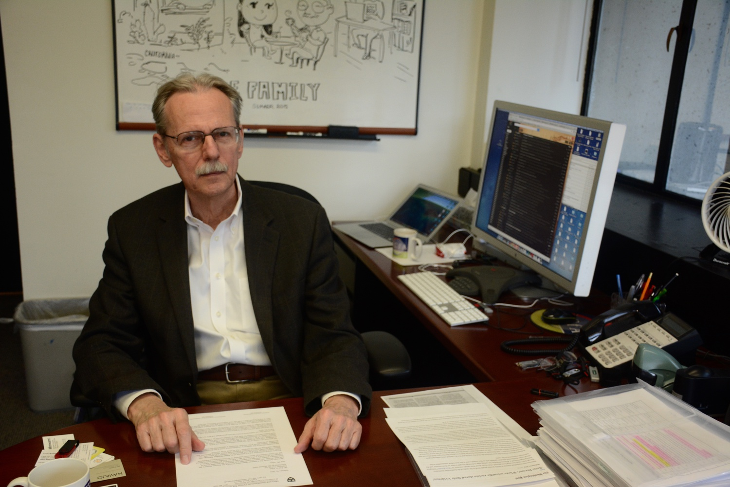 Astrophysics Professor Charles Alcock in his office.