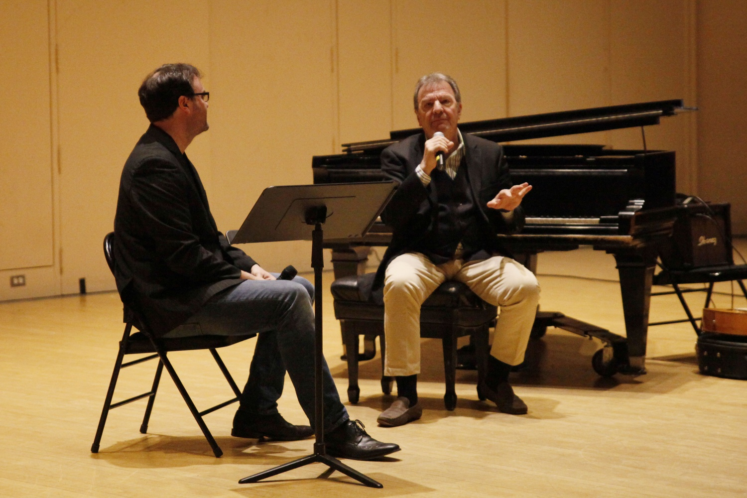 Professor Thomas Wisniewski (left) and Pablo Ziegler (right) talk during a special meeting of 149DA: Argentine Tango: Culture, Music, and the Dance on Thursday afternoon.  Ziegler, an Argentine pianist and composer, gave a lecture and led a master class.