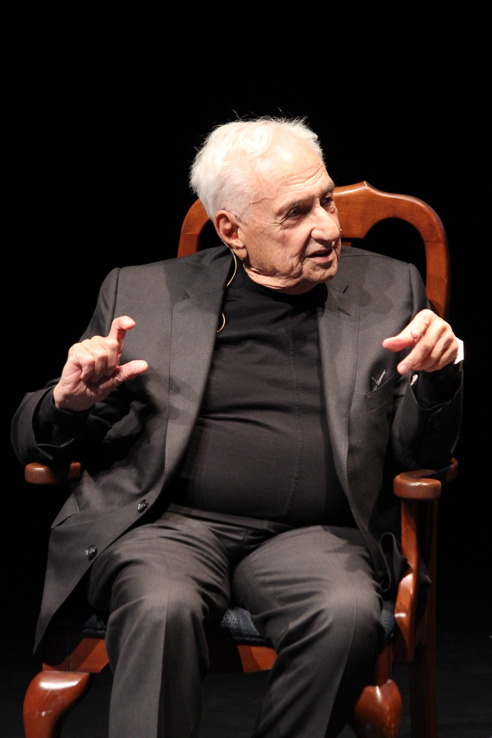 Architect Frank O. Gehry speaks with moderator John A. Lithgow '67 at the 2016 Harvard Arts Medal Ceremony in Farkas Hall. Harvard University President Drew G. Faust presented Gehry with the medal for his renowned work in architecture.