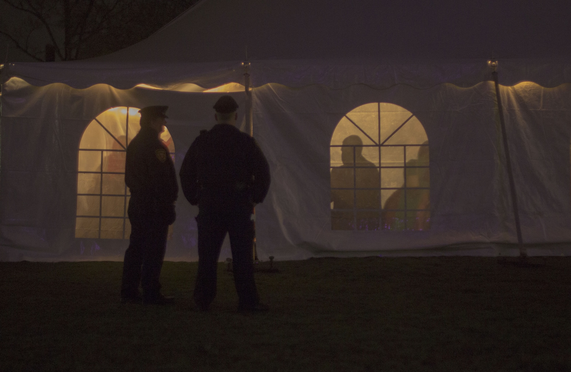 Security officers watch over the Quad Formal Friday. Though HUPD is present around campus all hours of the day, extra security is required for formals and similar events, adding an additional cost to event budgets.