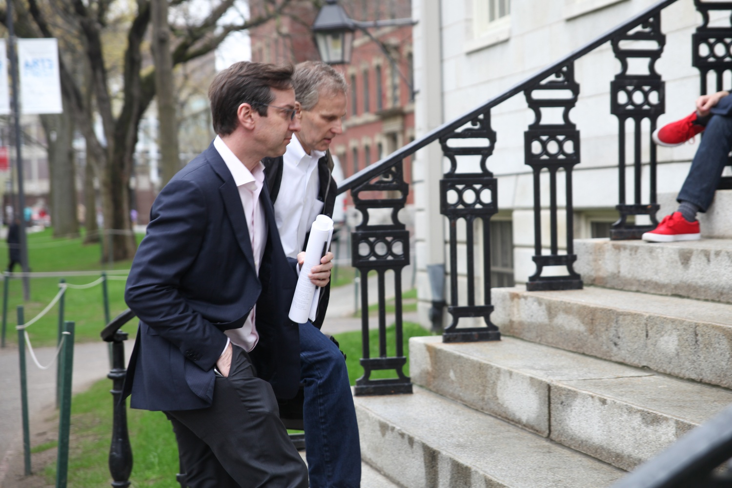 David I. Laibson '88, chair of the Economics Department, and Jeffrey A. Myron, the department's director of undergraduate studies, head into University Hall on Tuesday afternoon for a Faculty meeting.